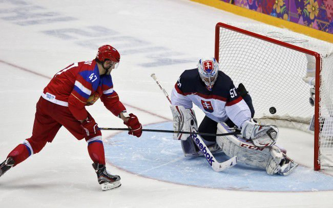 Russia's Radulov scores on Slovakia's goalie Laco on his team's first shootout attempt during their men's preliminary round ice hockey game at the Sochi 2014 Winter Olympic Games