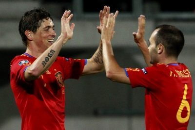 Torres and his team mate Iniesta of Spain celebrate after he scored during their Euro 2012 qualifying soccer match against Liechtenstein in Vaduz